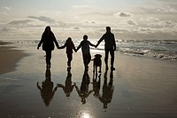 Family and dog by the sea (thumbnail)