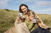 Mother and daughter outdoors with drinks (thumbnail)