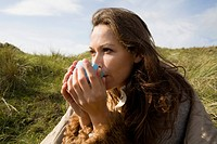 Woman outdoors with drink
