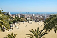 Tourists on a viewing platform with view over Barcelona, Park Gueell, Architect Antoni Gaudi, Barcelona, Catalonia, Spain