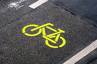 Yellow bike, symbol on a bicycle path