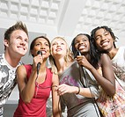 South African teen culture _ Group of young adults singing karaoke.