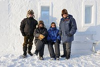 Senior tourists in front of Snowking  castle, Yellowknife, Northwest Territories, Canada