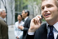 Businessman Talking on a Cell Phone, Focus on Foreground
