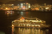 Cruise ship in Victoria Harbour with Kowloon east skyline in background, Hong Kong