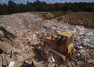 RUBBISH DUMP with bulldozer at work viewed from above