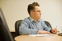 Businessman Working on Paperwork
