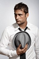 Mid adult man with fedora hat