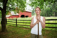 Gardener, barn in background portrait