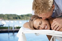 Couple embracing on lounge chair