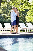 Couple dancing by pool (thumbnail)