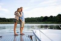Couple standing on pier (thumbnail)