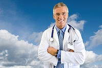 Portrait of smiling doctor in lab coat with background of clouds in blue sky