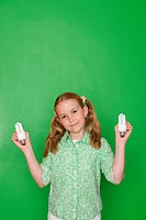 Girl holding compact fluorescent light bulbs