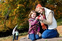 Grandparents and grandkids exploring in woods (thumbnail)