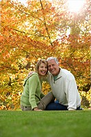 Portrait of couple sitting on lawn