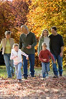 Multi_generation family walking in park