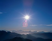 Sun Above Mountains