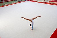 Female gymnast performing handstand, elevated view