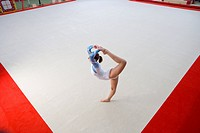 Female gymnast performing, elevated view