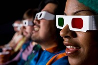Audience in cinema wearing 3D glasses, close_up