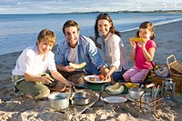 Portrait of family having picnic on beach