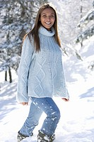 Portrait of young woman standing in snow (thumbnail)