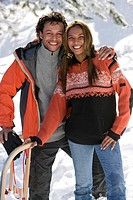 Portrait of mixed race couple with snow sled