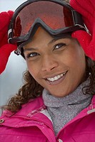 Portrait of young mixed race woman wearing ski goggles