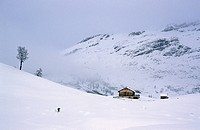 Woman snowshoeing near the Grossfanes hut Dolomites Italy