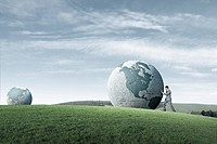 businessman rolling globe
