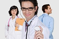 female doctors and a male doctor holding a stethoscope