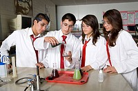 High School Students Conducting Science Experiment