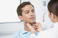Patient Being Examined by Doctor