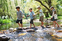 Children Crossing a Stream