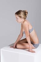 woman wearing underwear and empty box