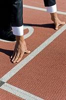 Runner Poised on Track