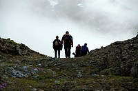 Silhouettes of hikers on a pass Eastgreenland