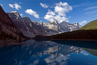 Early morning reflection of the Wenkchemna Peaks in Moraine Lake, Valley Of The Ten Peaks, Banff National Park, Alberta, Canada