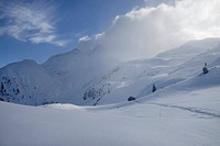 Foehn clouds over recently snowed up untouched winter landscape in the Zillertal alps Tyrol Austria