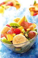 Fruit salad: kiwis, grapes, bananas, apples, mango and peaches
