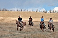 Tourists travelling on horseback with Mongolian guide, north central Mongolia No releases available