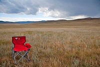 Lone traveller's chair in the magnificent Mongolia steppes waiting for you, north central Mongolia