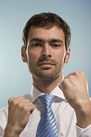 Businessman with his fists raised, boxing pose, fighting fists