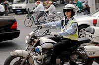 Traffic policeman on motorcycle, Shanghai, China