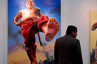 Chinese gallery goer beside large scale oil painting by contemporary Chinese artist, Shanghai, China