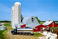 Livestock _ A milk tank truck loads milk at a small family operated dairy farm / WI.