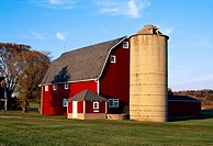 Agriculture _ Red barn and silo in Autumn with green lawn in the foreground / WI _ Waterford