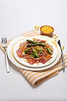 Beef carpaccio with green asparagus and mustard dressing