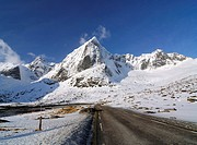 Road going through a mountainous winter landscape, Lofoten Archipelago, Norway, Scandinavia